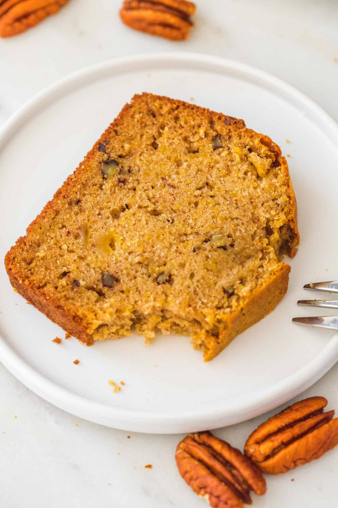 A slice of sweet potato bread served on a small white plate