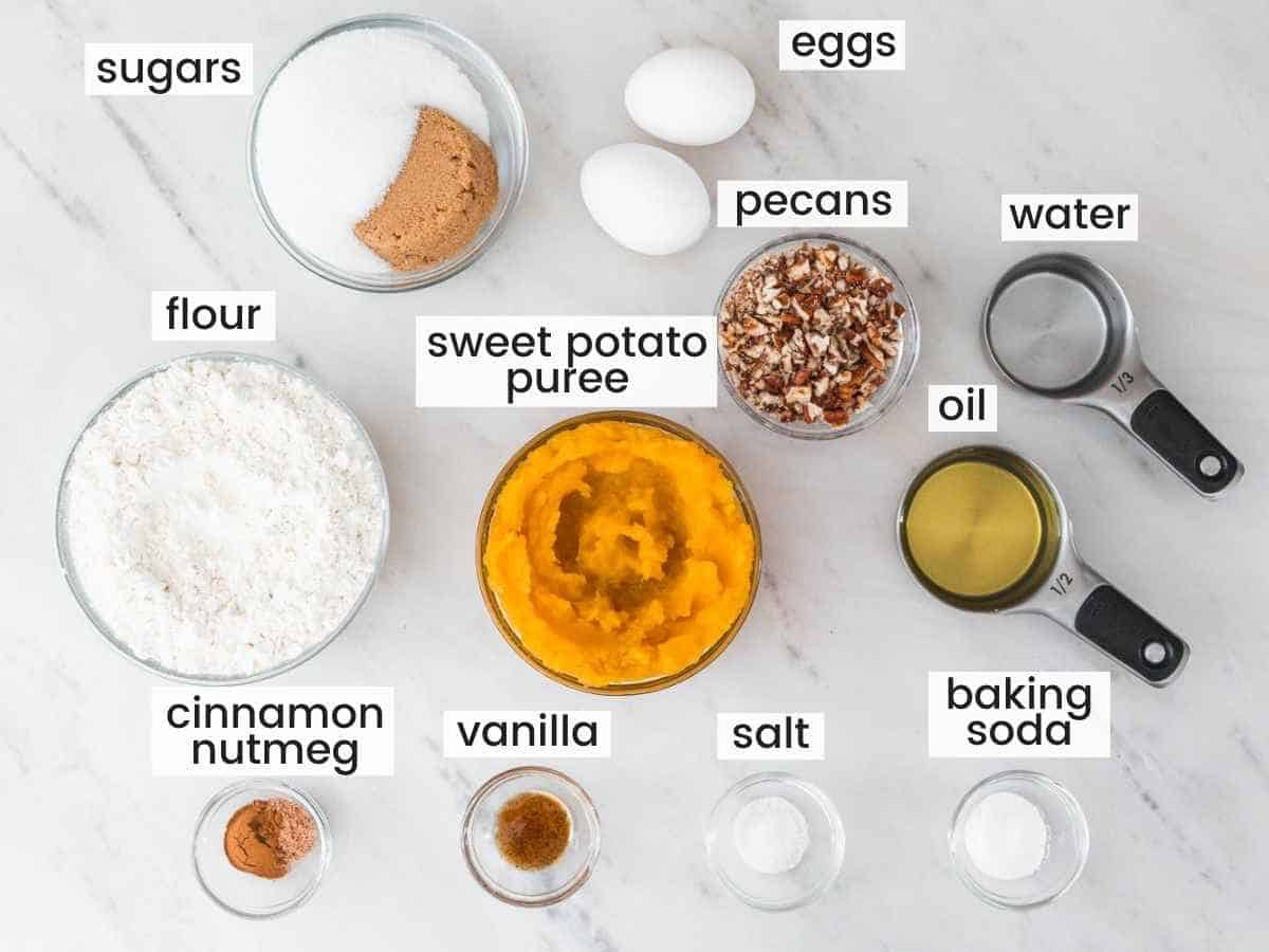 ingredients needed to make sweet potato bread including sweet potato puree, flour, sugars, vanilla, eggs, oil, water, pecans, spices.