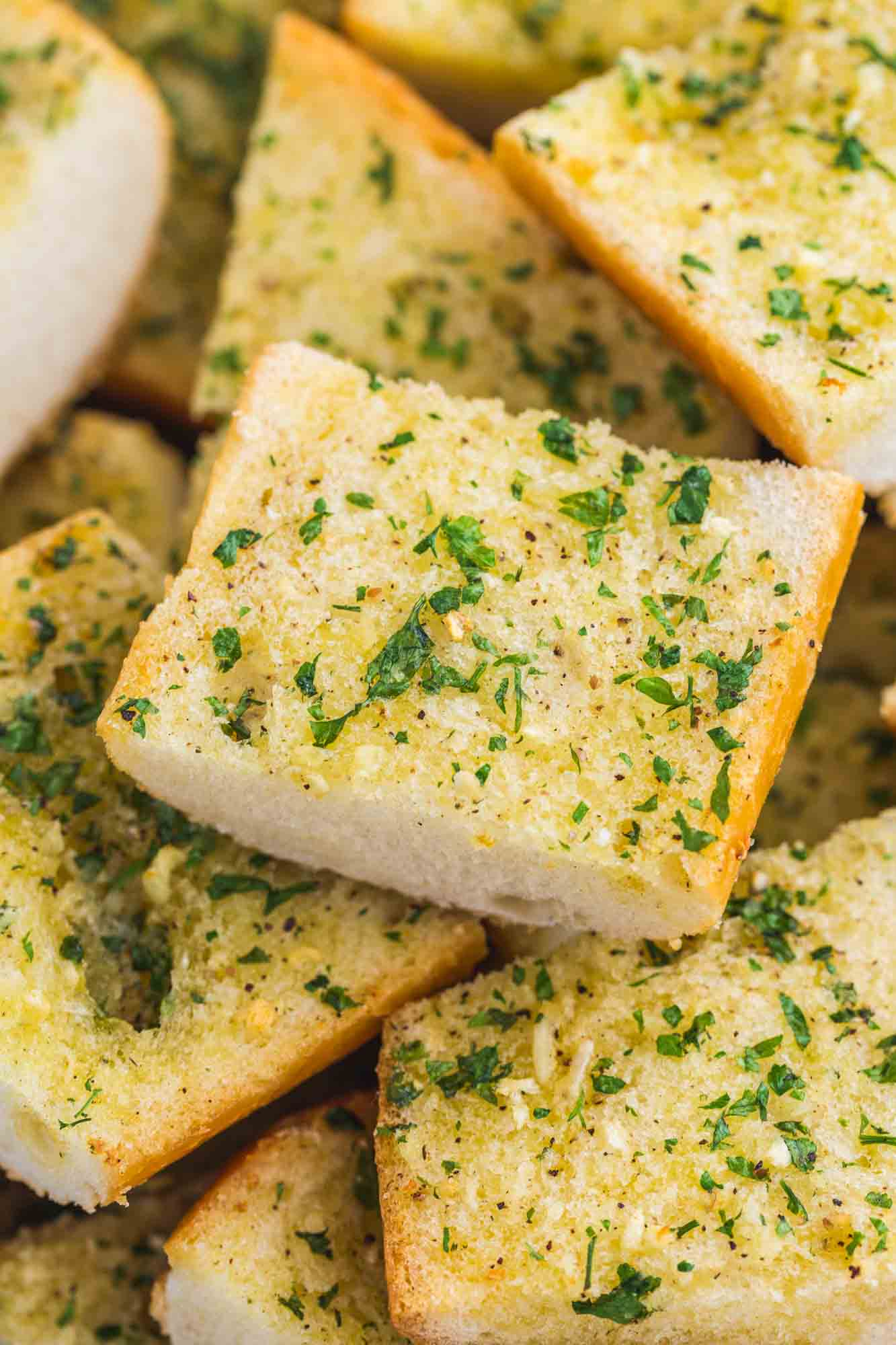 Close up shot of slices of toasted garlic bread