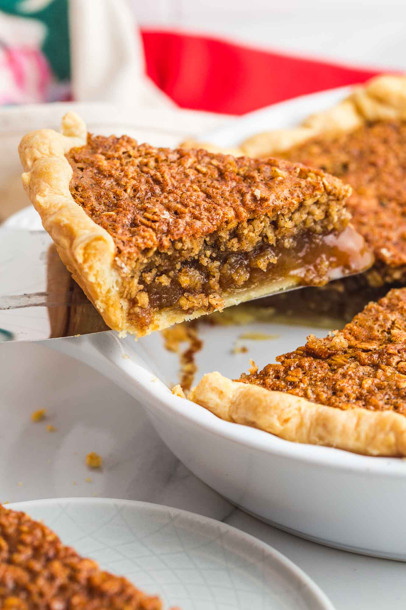 Taking a slice of oatmeal pie from a whole pie