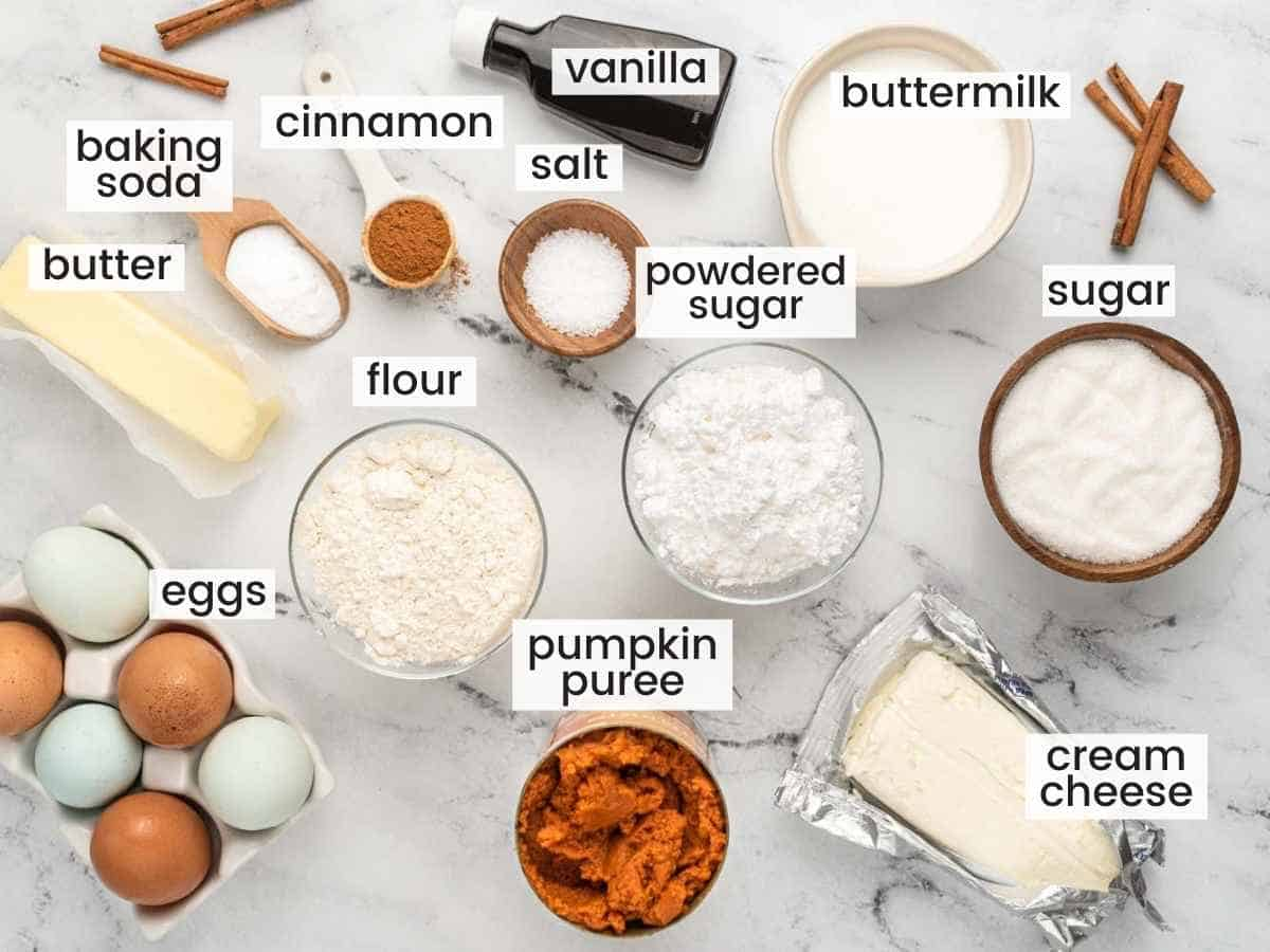 Ingredients needed to make a pumpkin cake with cream cheese frosting