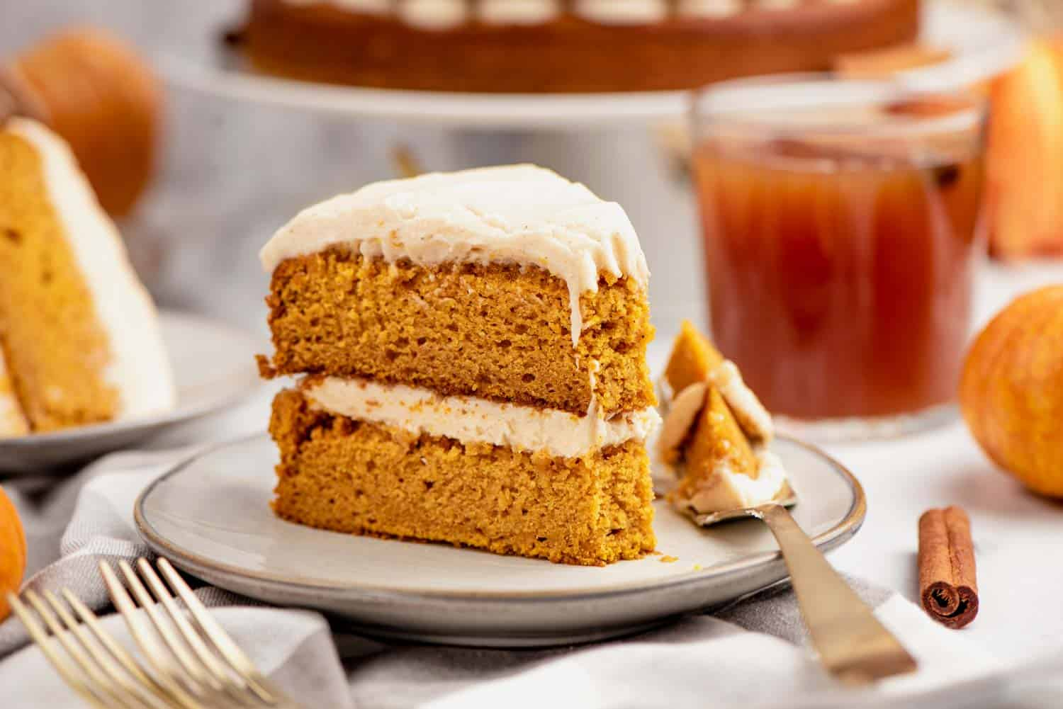A slice of pumpkin cake on a plate with a fork