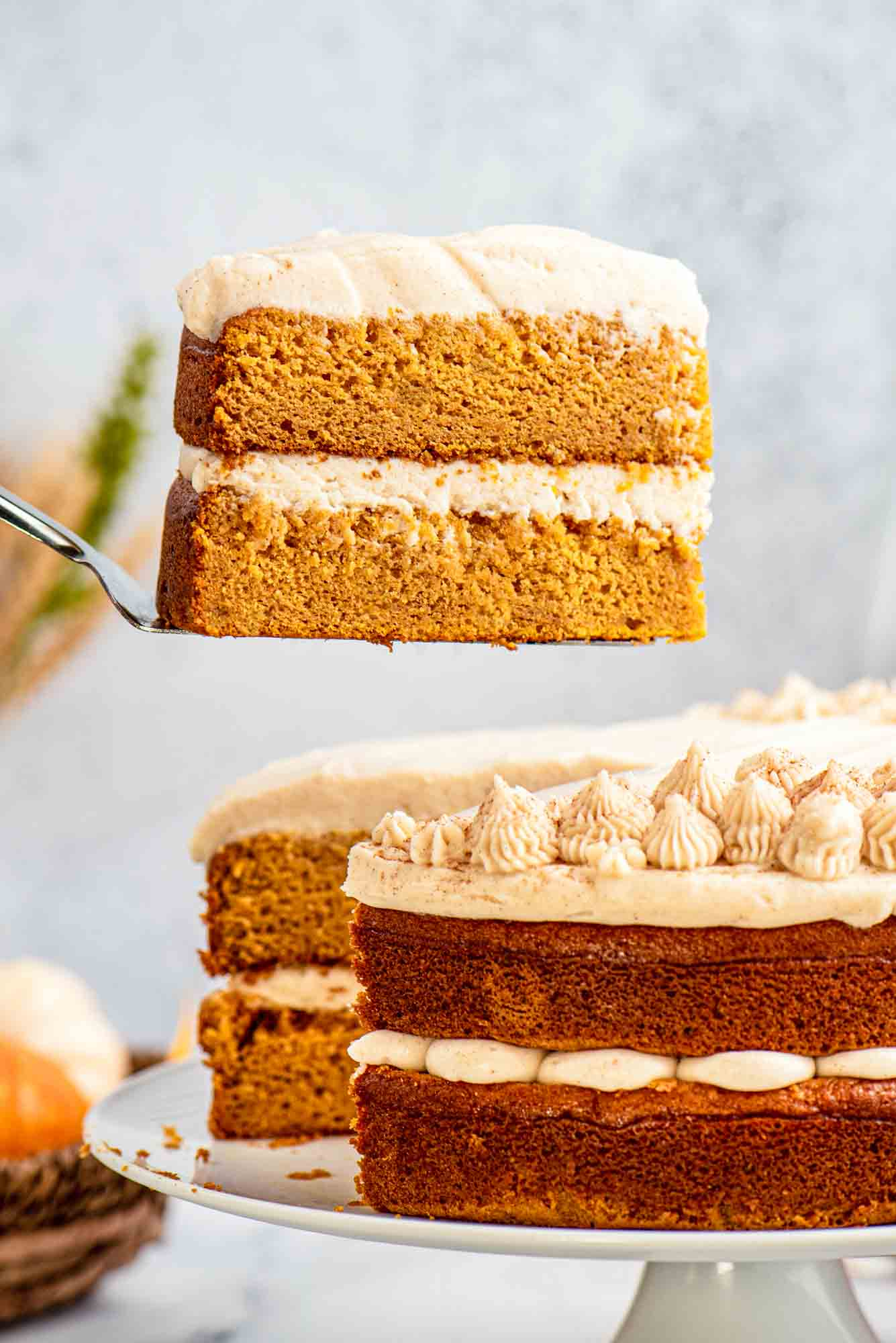 Taking a slice of pumpkin cake