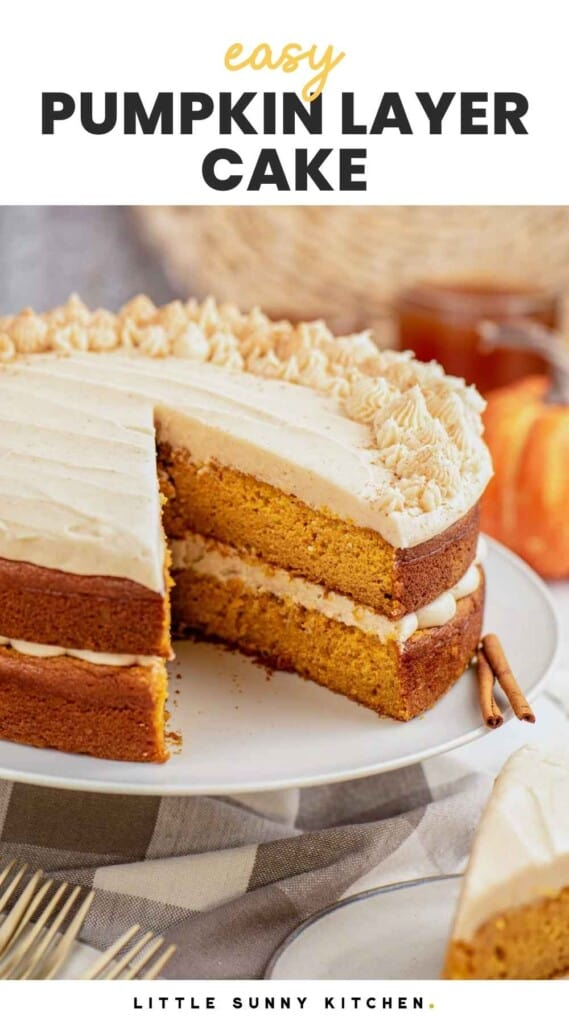 """Pumpkin layer cake on a cake stand, frosted with cream cheese frosting, and overlay text that says """"easy pumpkin layer cake"""""""