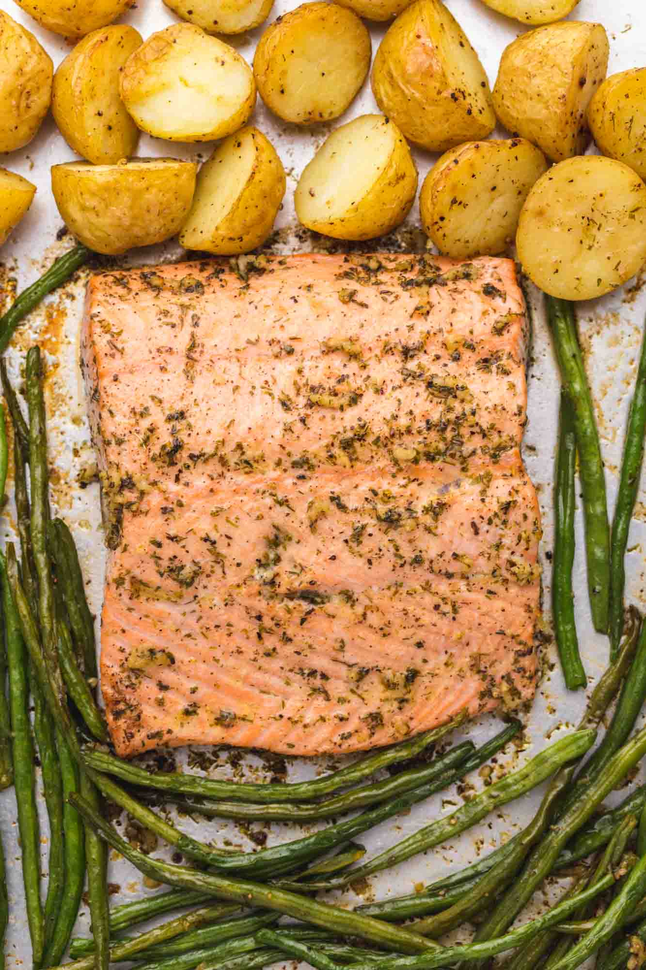 Overhead shot of a sheet pan salmon with green beans and potatoes