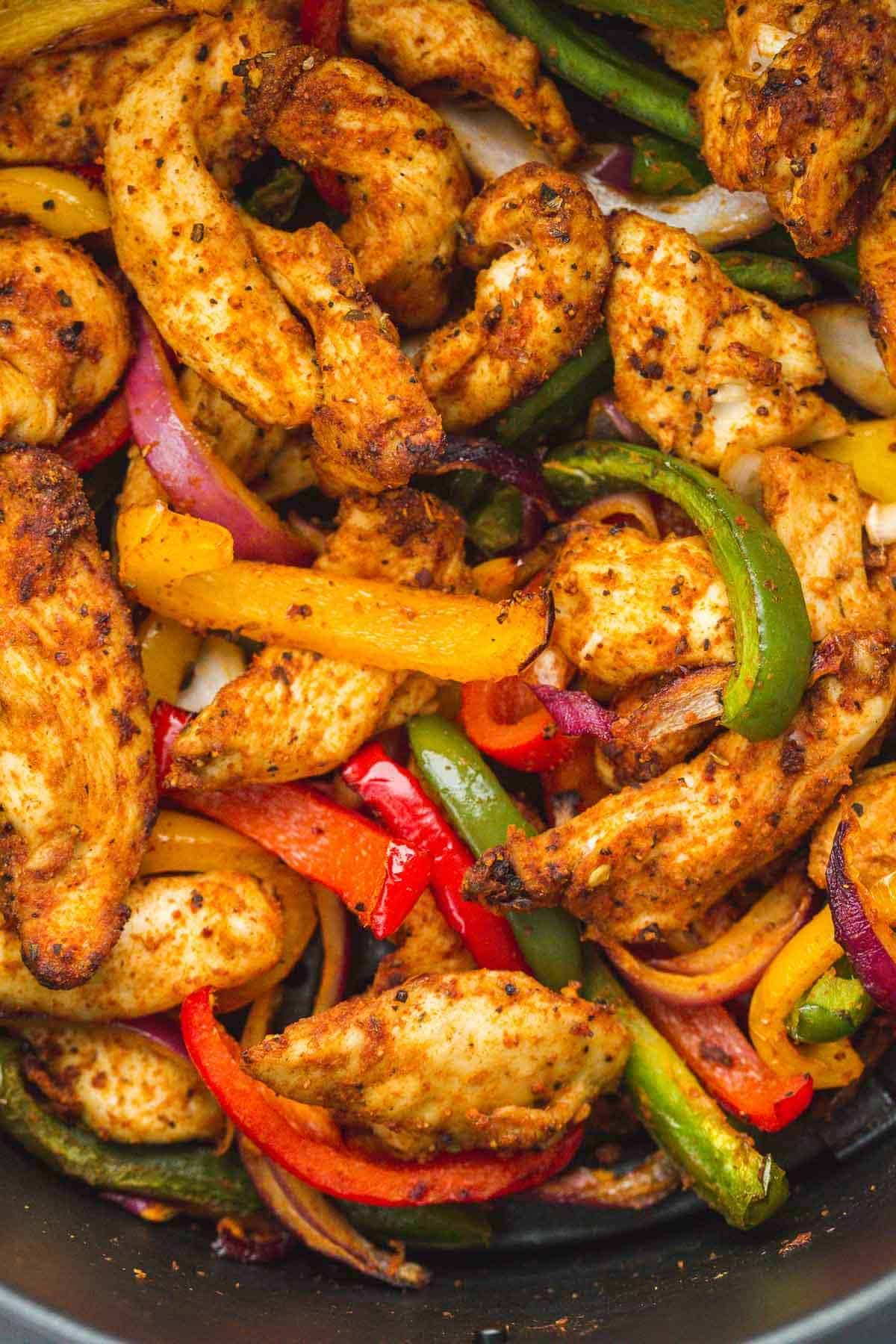 A close up shot of chicken fajitas.