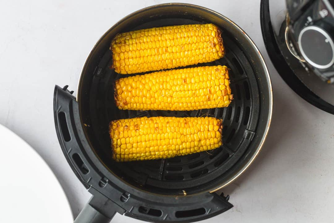Cooked three corn on the cob in an air fryer basket.