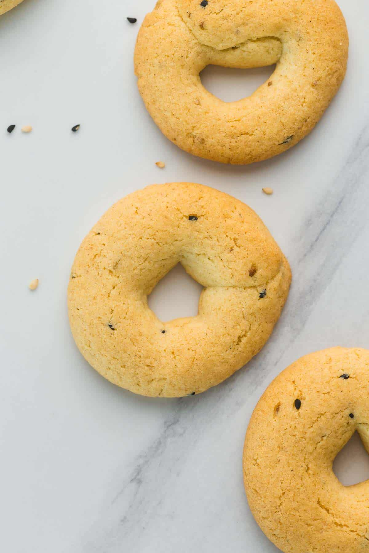 3 aniseed cookies on a white marble counter