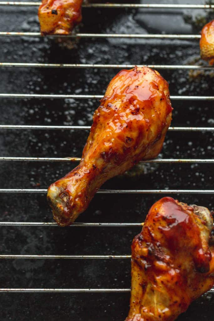 A chicken drumstick glazed with BBQ sauce