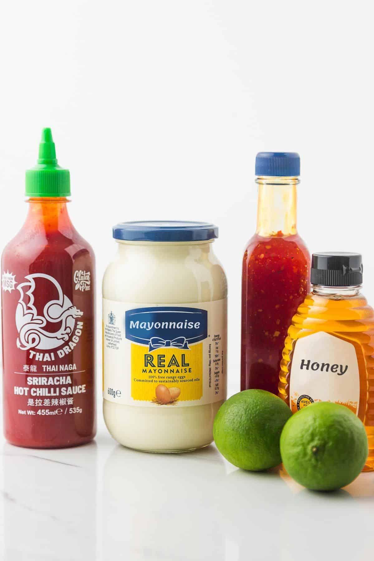 Bang bang sauce ingredients. Sriracha, mayo, sweet chili sauce, honey, and 2 limes.