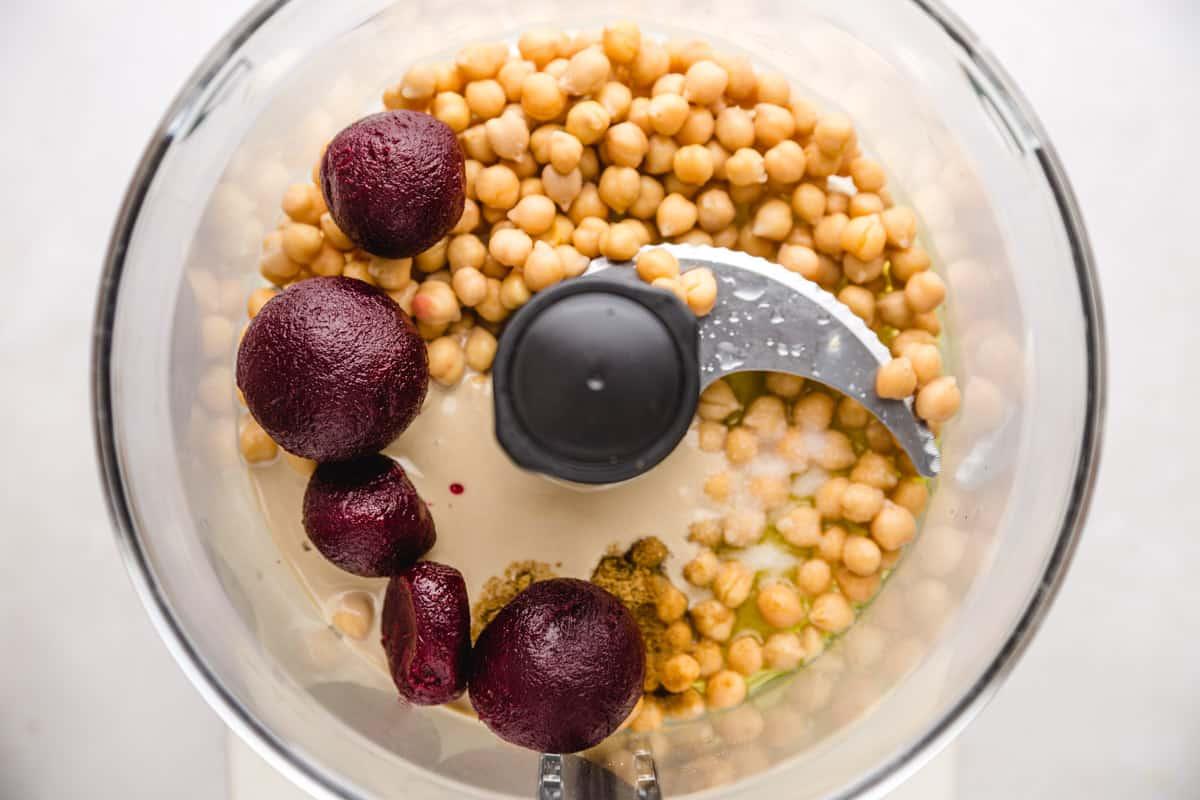 beet hummus ingredients in a food processor