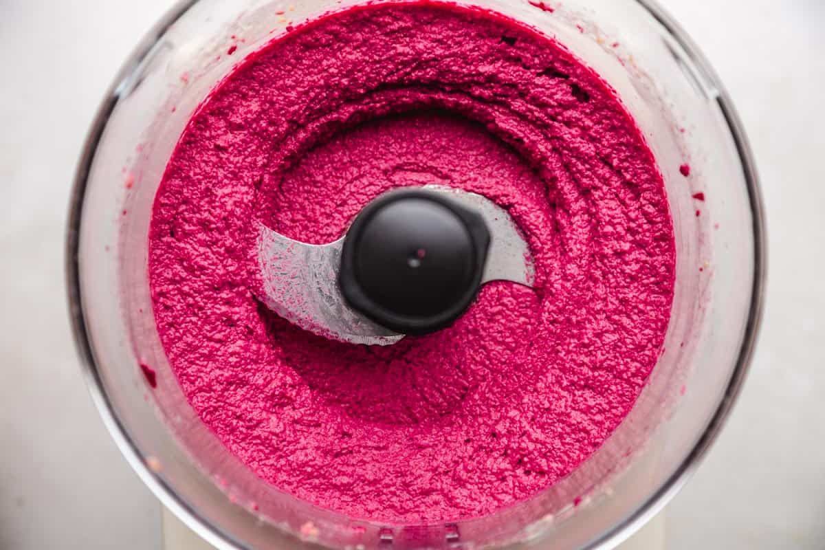 beet hummus ready in a food processor bowl