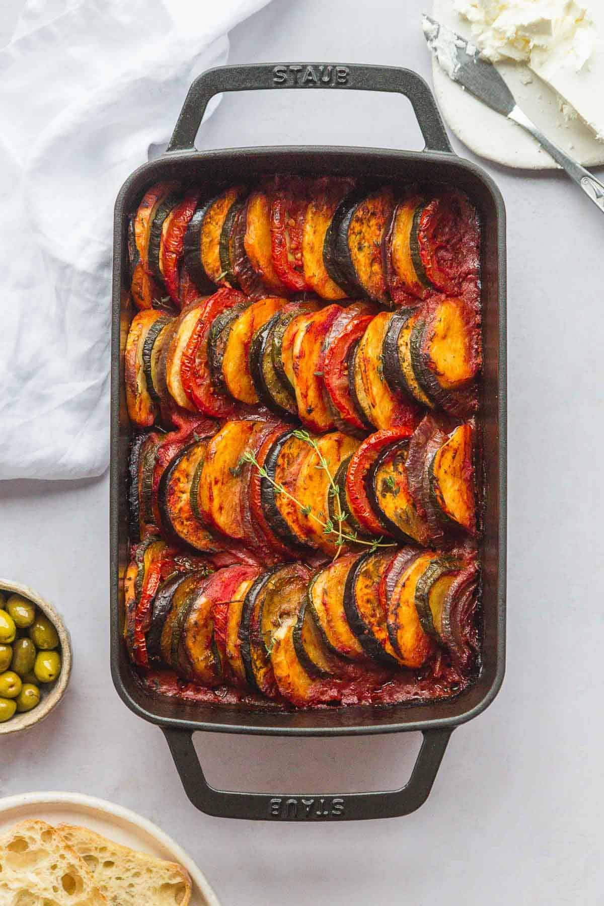 Roasted Greek vegetables in a black Staub baking dish