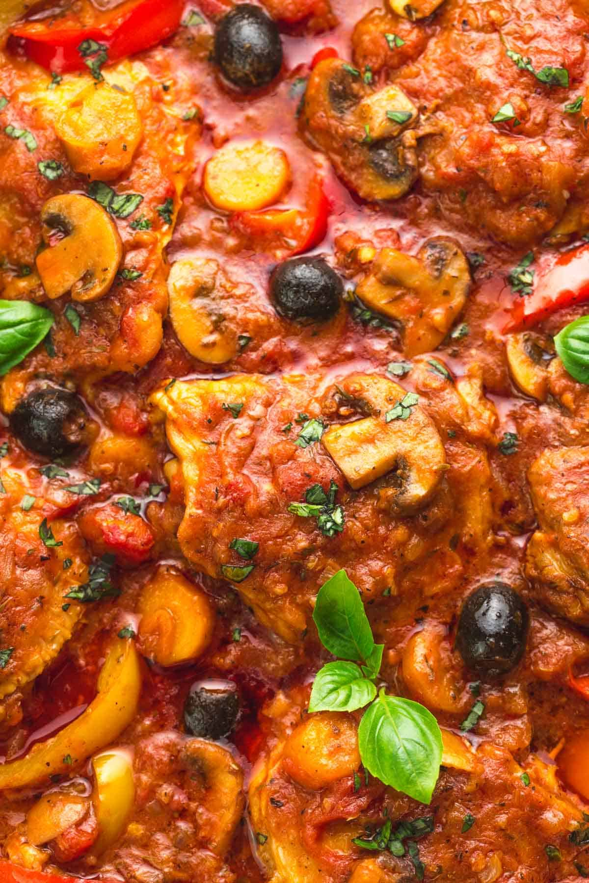 Close up of chicken cacciatore with mushrooms and olives