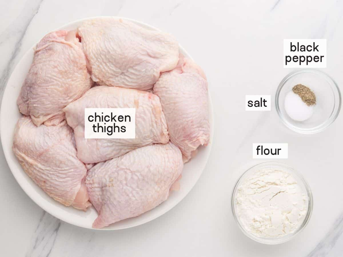 Ingredients needed for the chicken. Chicken thighs, salt, pepper, and flour.
