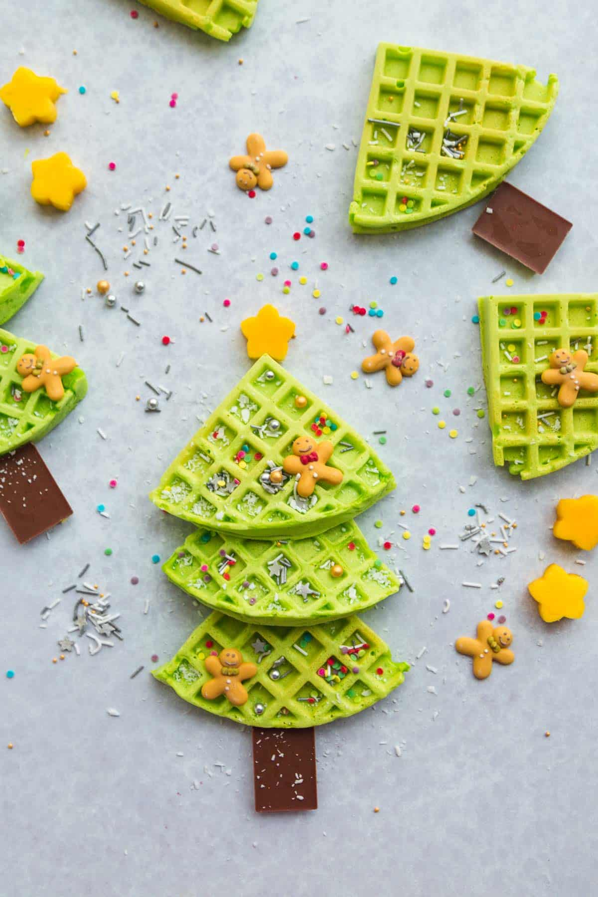 Christmas tree waffles decorated with sprinkles and candy
