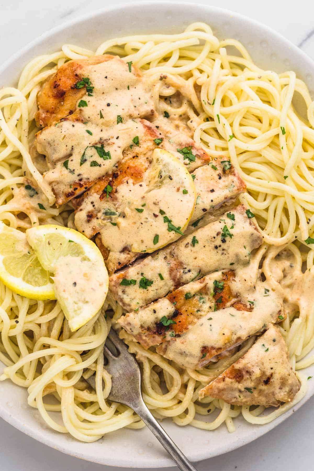 creamy lemon chicken served over pasta