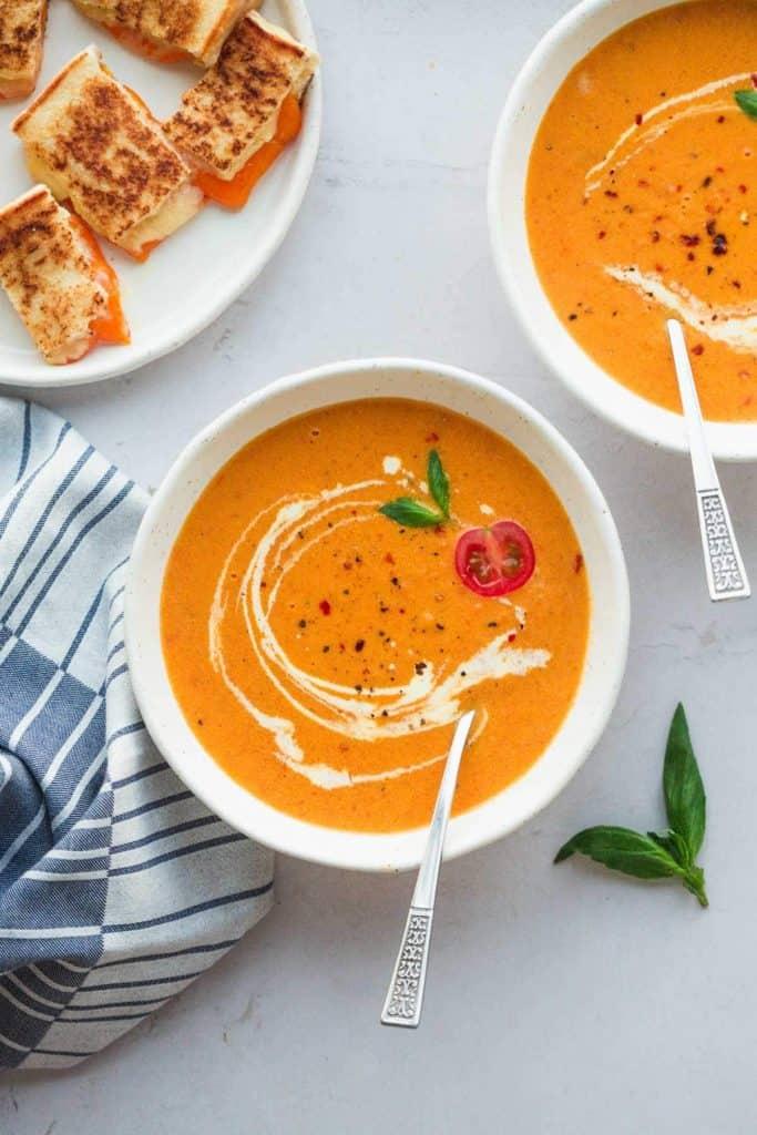 Creamy Tomato Bisque in white soup bowls