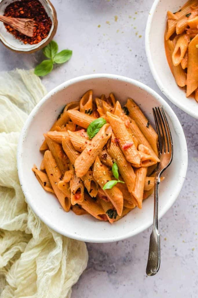 Creamy Tomato Pasta in 2 white bowls and a fork