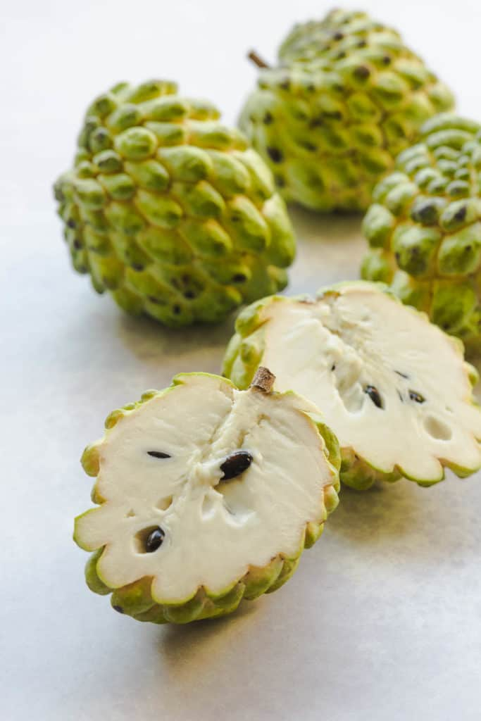 custard apples on a white background