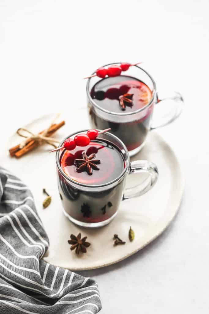 2 mugs of gluhwein mulled wine on a small white tray