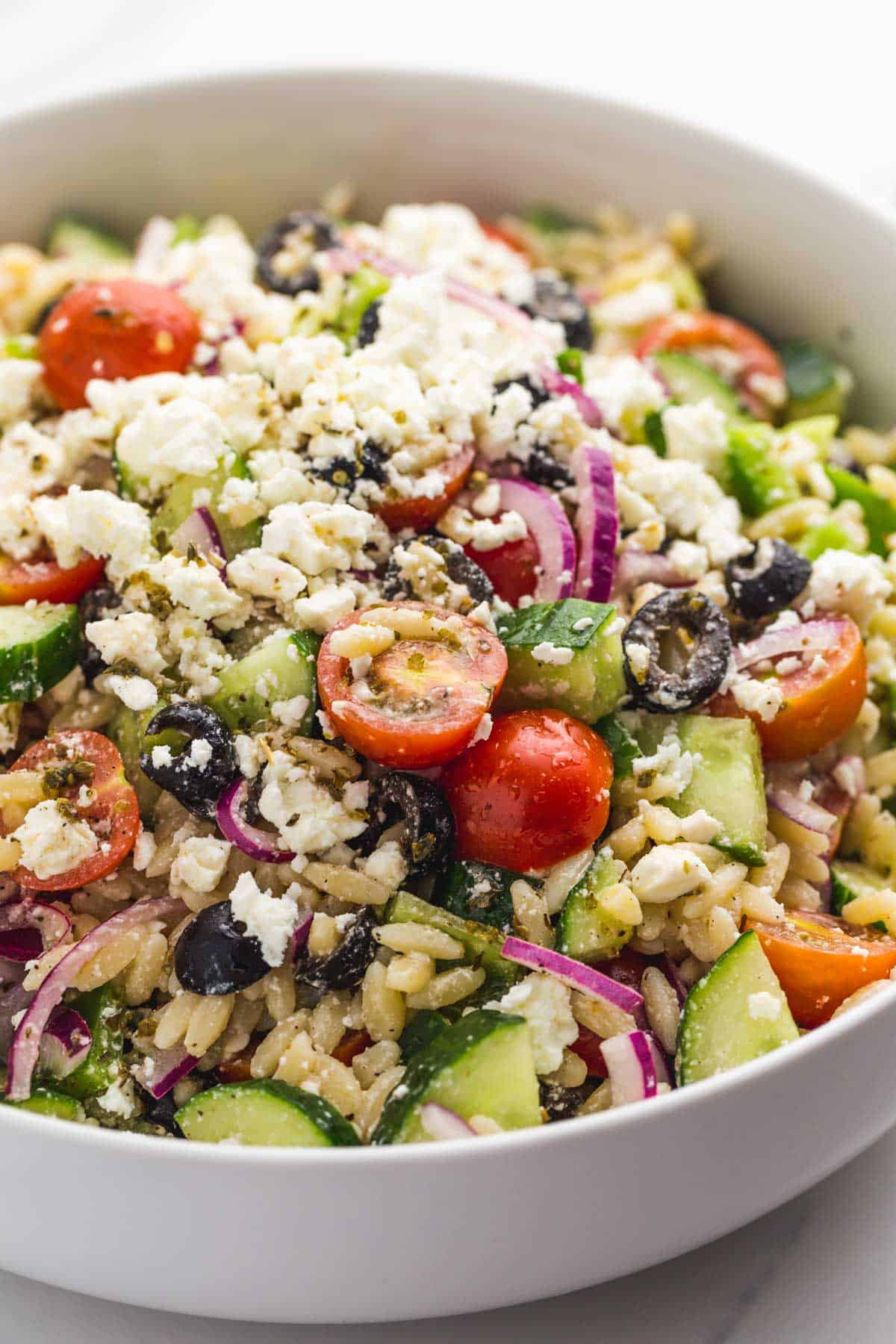 Greek Orzo Salad in white w large salad bowl