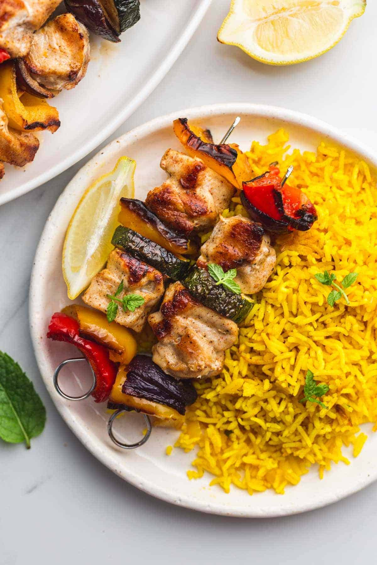 Turmeric rice with chicken kabobs