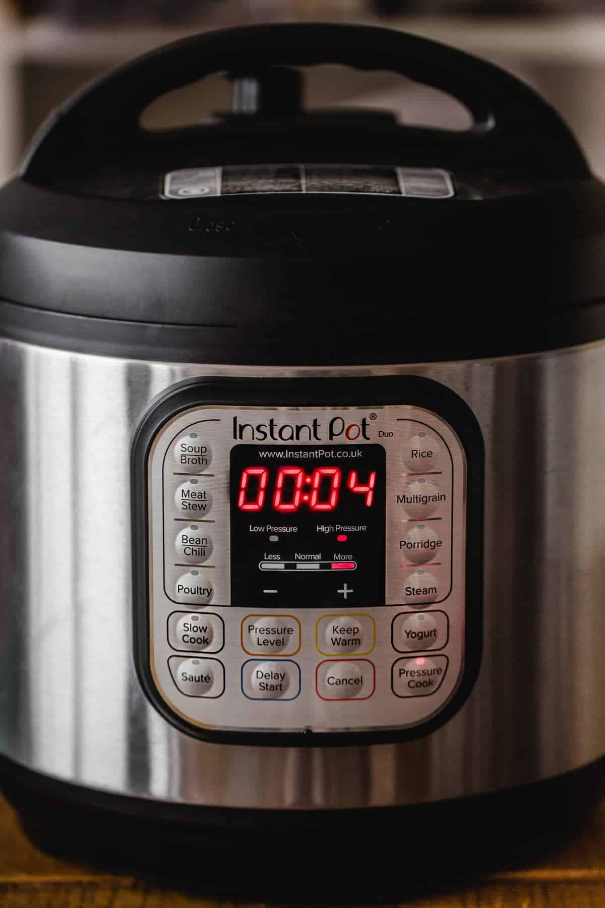 Close up shot of the instant pot working with the pressure cook setting