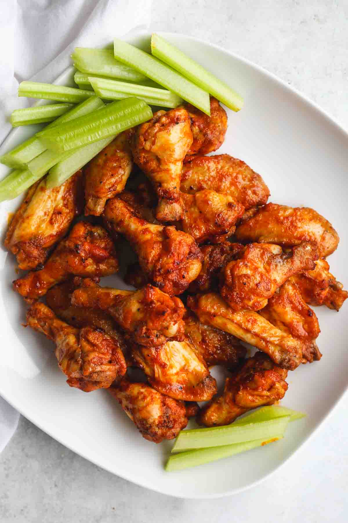Instant Pot chicken wings served on a white platter with celery sticks