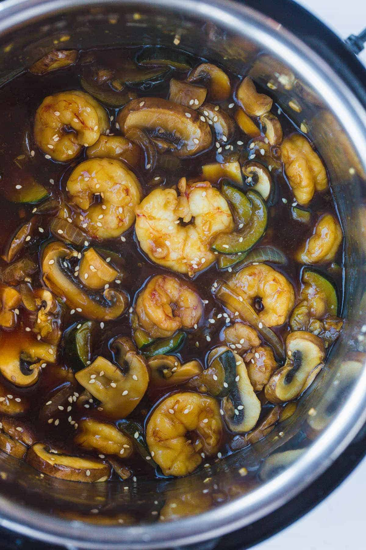 An Instant Pot with shrimp hibachi with extra sauce