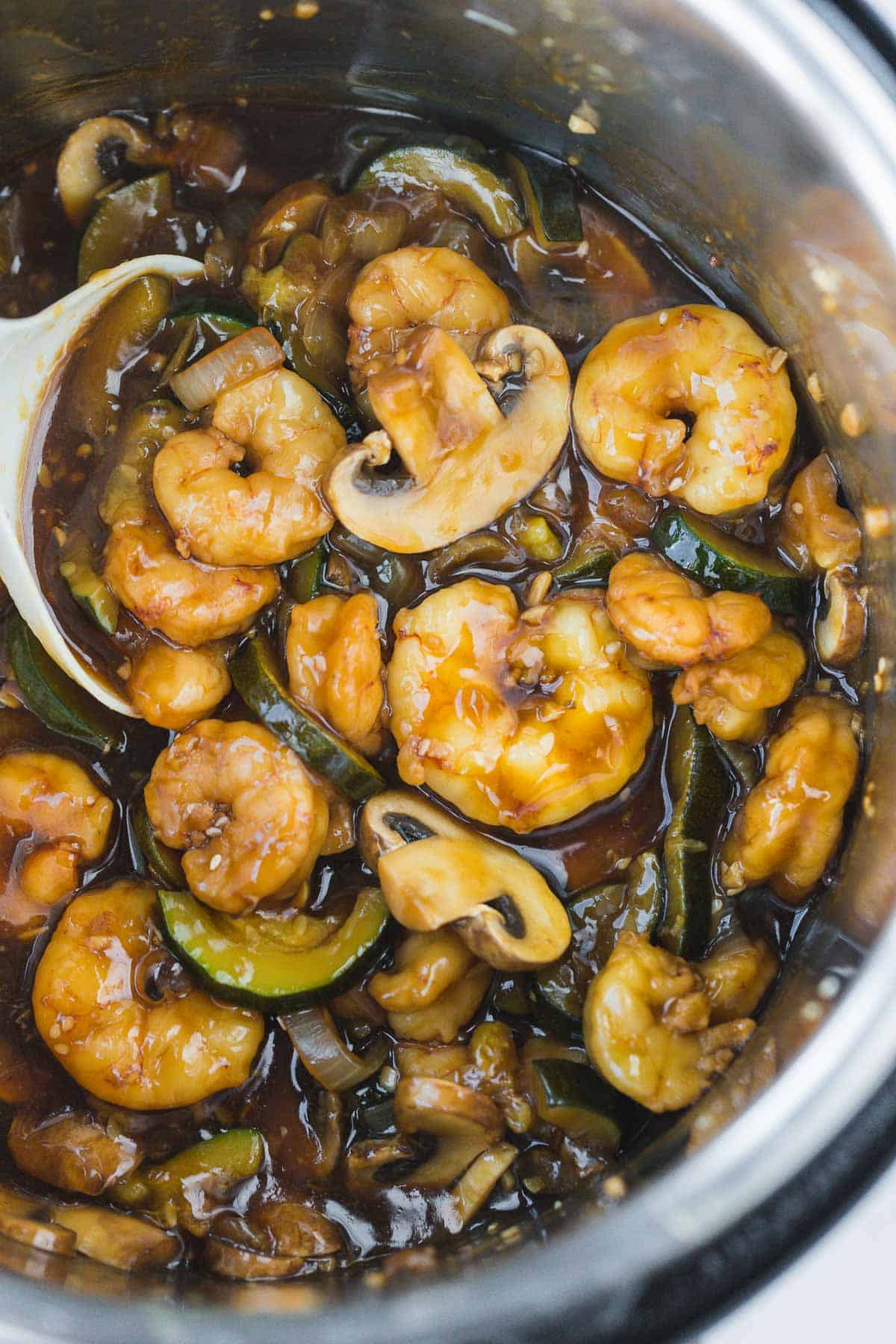 Shrimp hibachi cooked in the instant pot photographed with a serving spoon