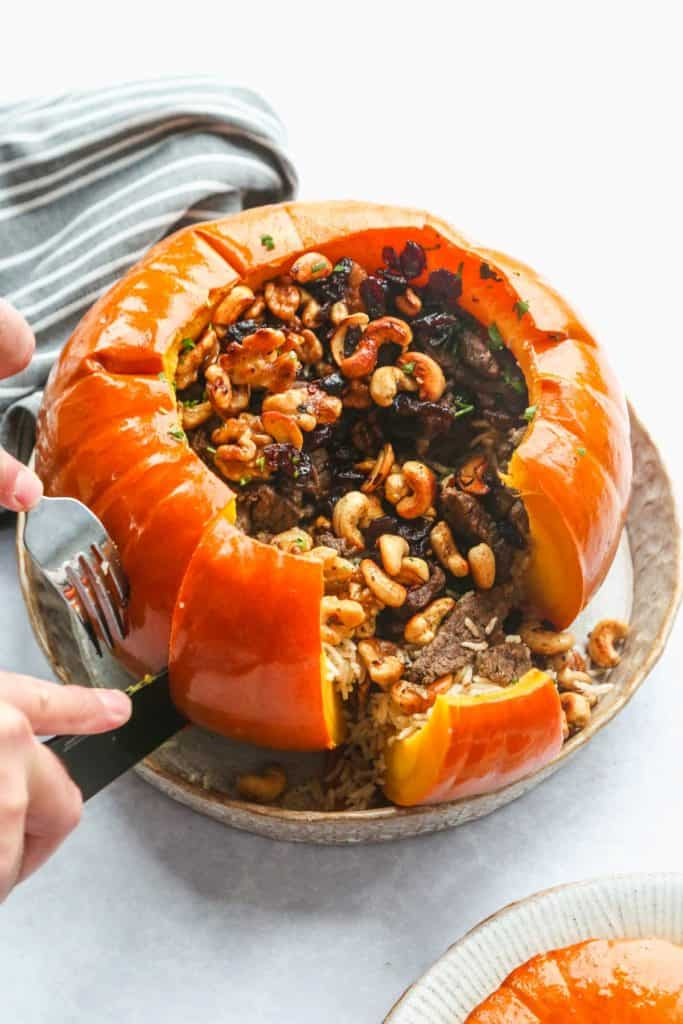 Cutting through the instant pot stuffed pumpkin with a knife
