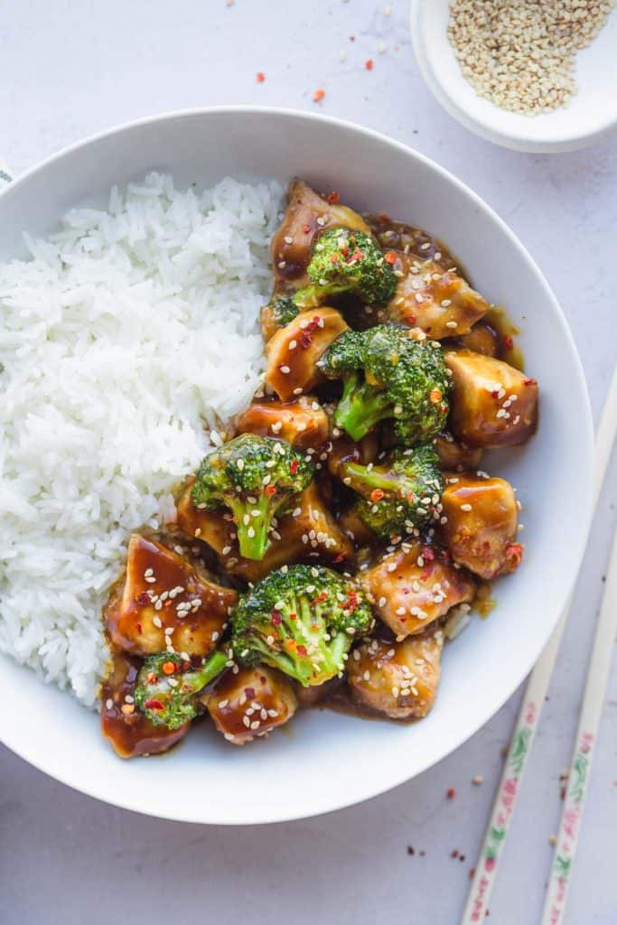 Instant Pot Chinese Chicken and broccoli with basmati rice in a white bowl