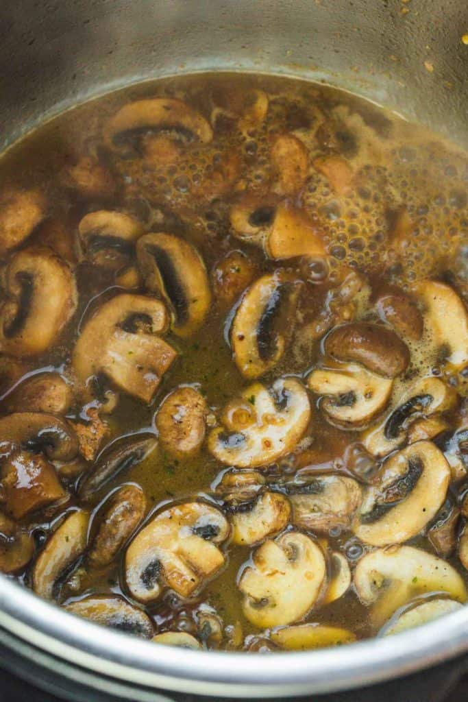 Cooked mushrooms in a syrup-like marsala sauce