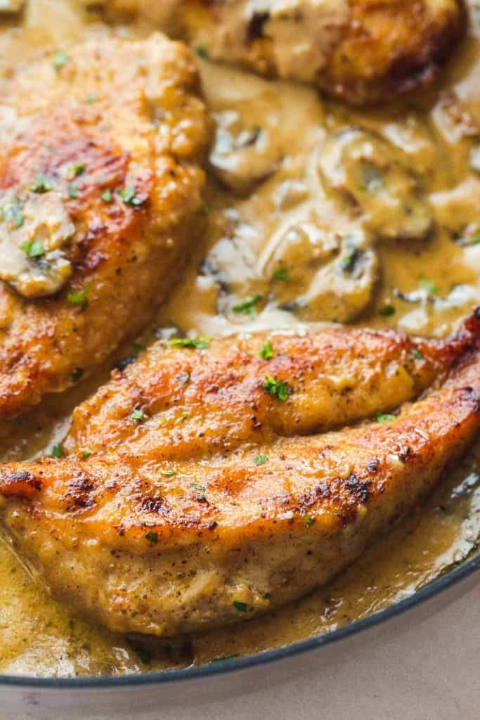 Instant Pot marsala chicken breast in a serving dish with creamy mushroom marsala sauce