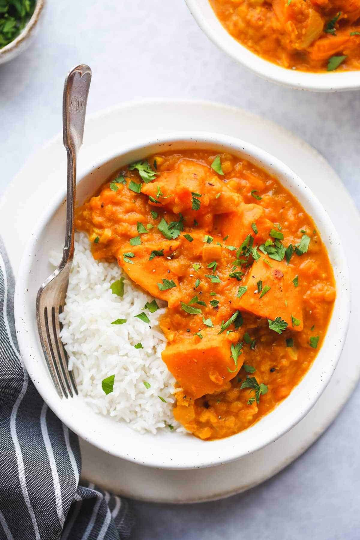 Instant pot pumpkin curry in a white bowl