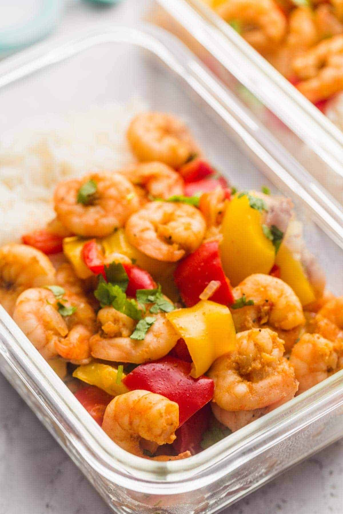 Instant Pot Spicy Cajun Pepper Shrimp in meal prep containers with rice
