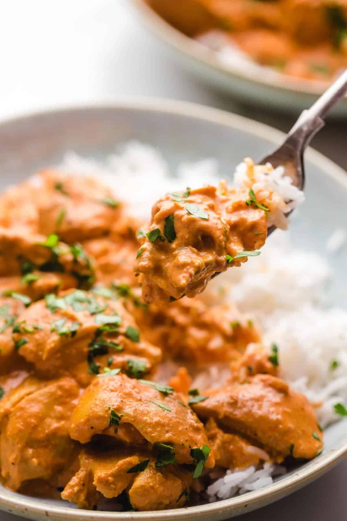 Eating chicken tikka masala with a fork