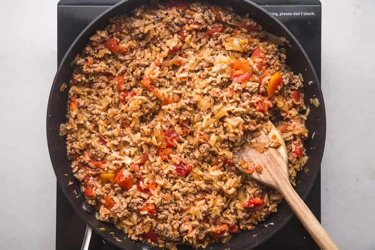 Rice and turkey cheesy stuffing in a pan