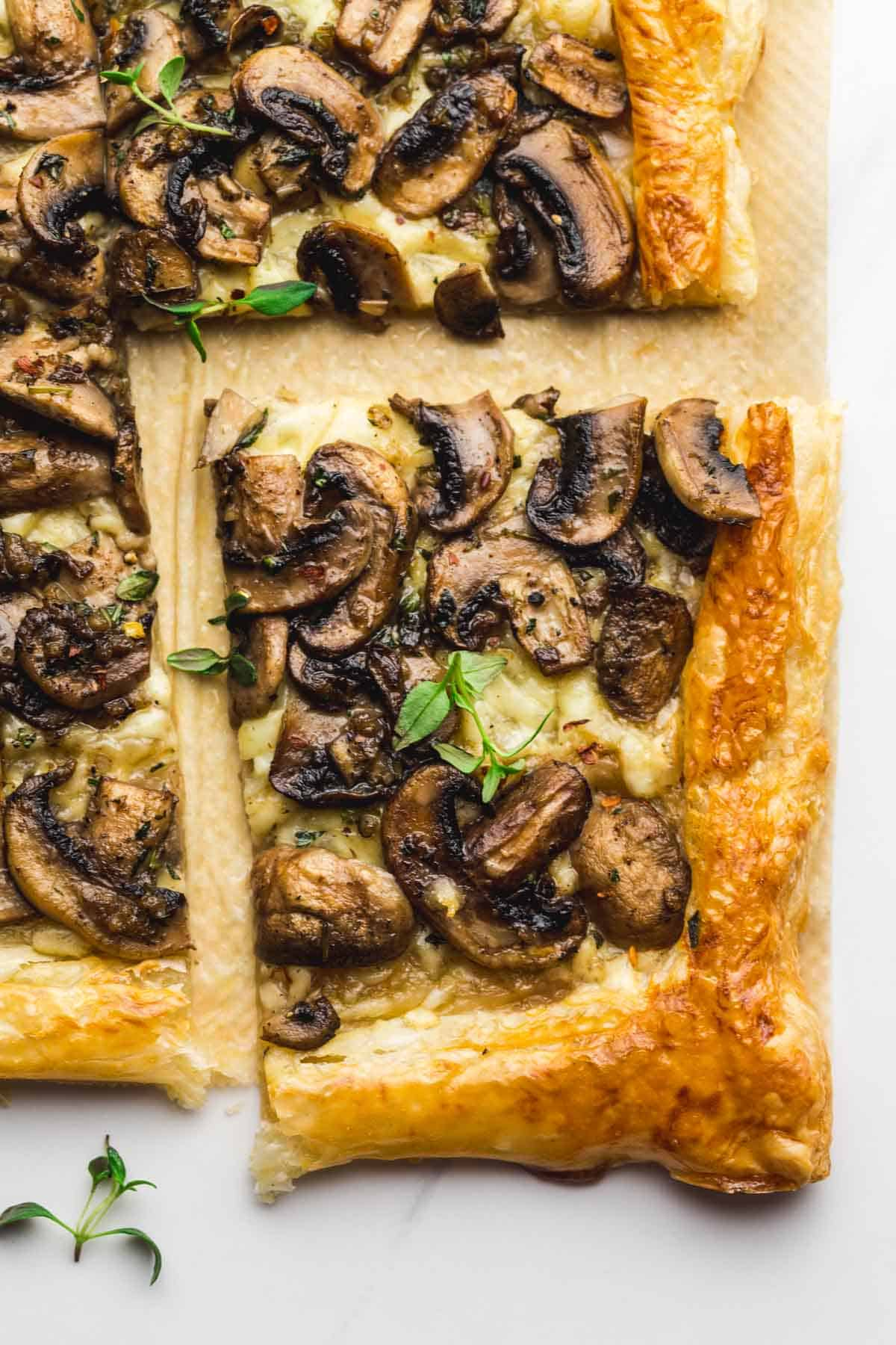 A slice of mushroom tart on parchment paper