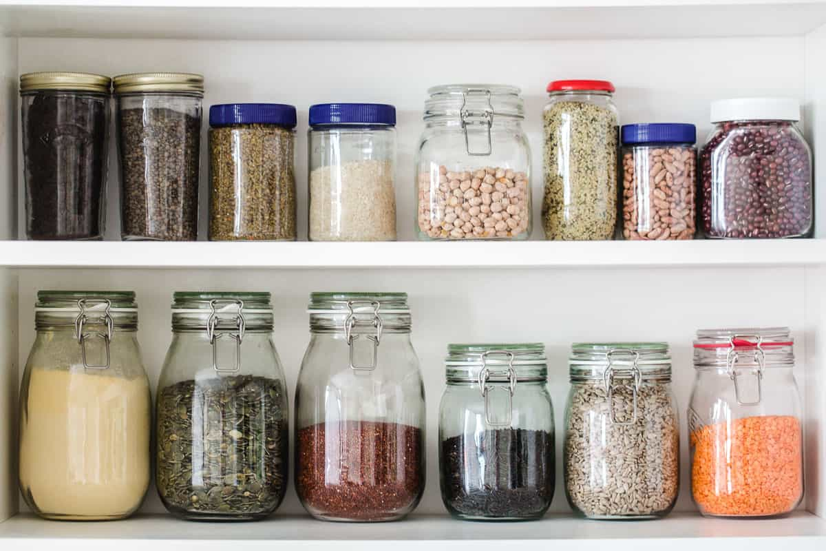 Pantry - jars filled with nuts, seeds, and legumes