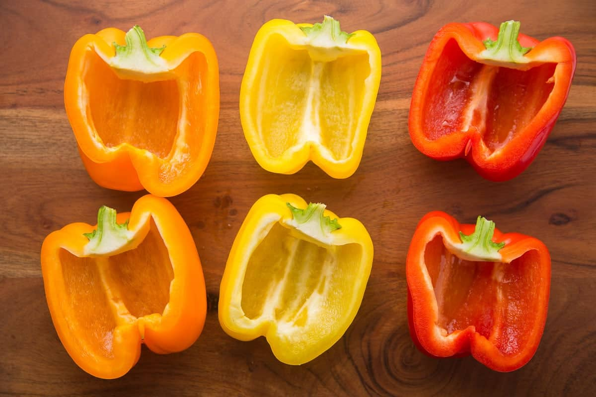 3 colorful bell peppers sliced in halves