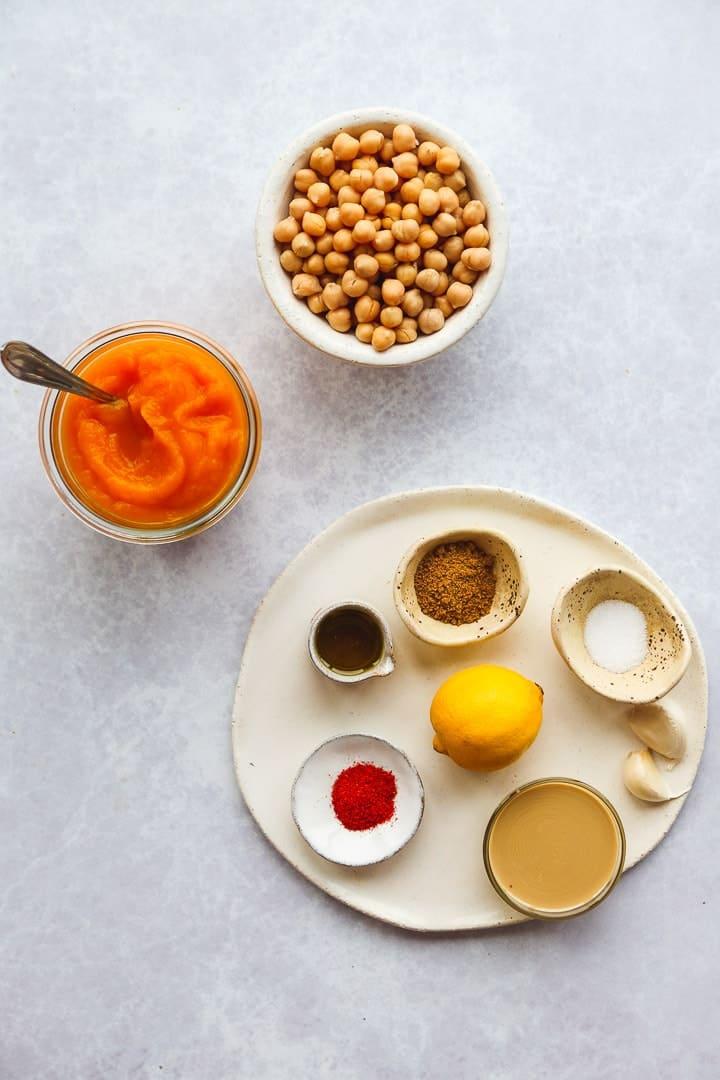 A flat lay with pumpkin hummus ingredients