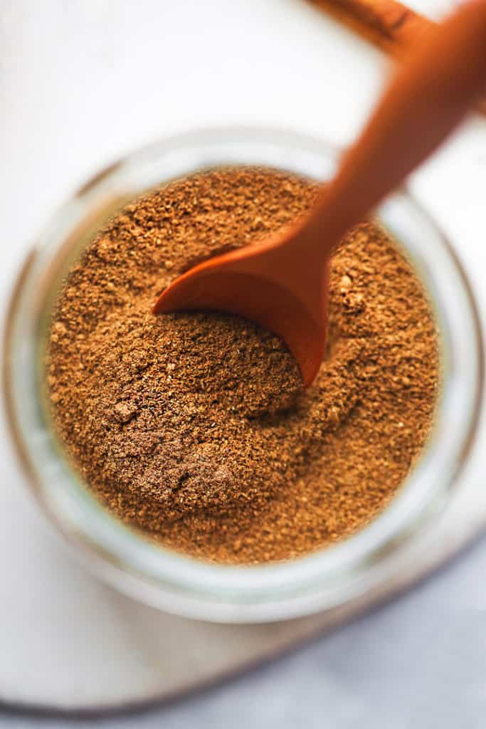 A close up shot of pumpkin pie spice in a jar