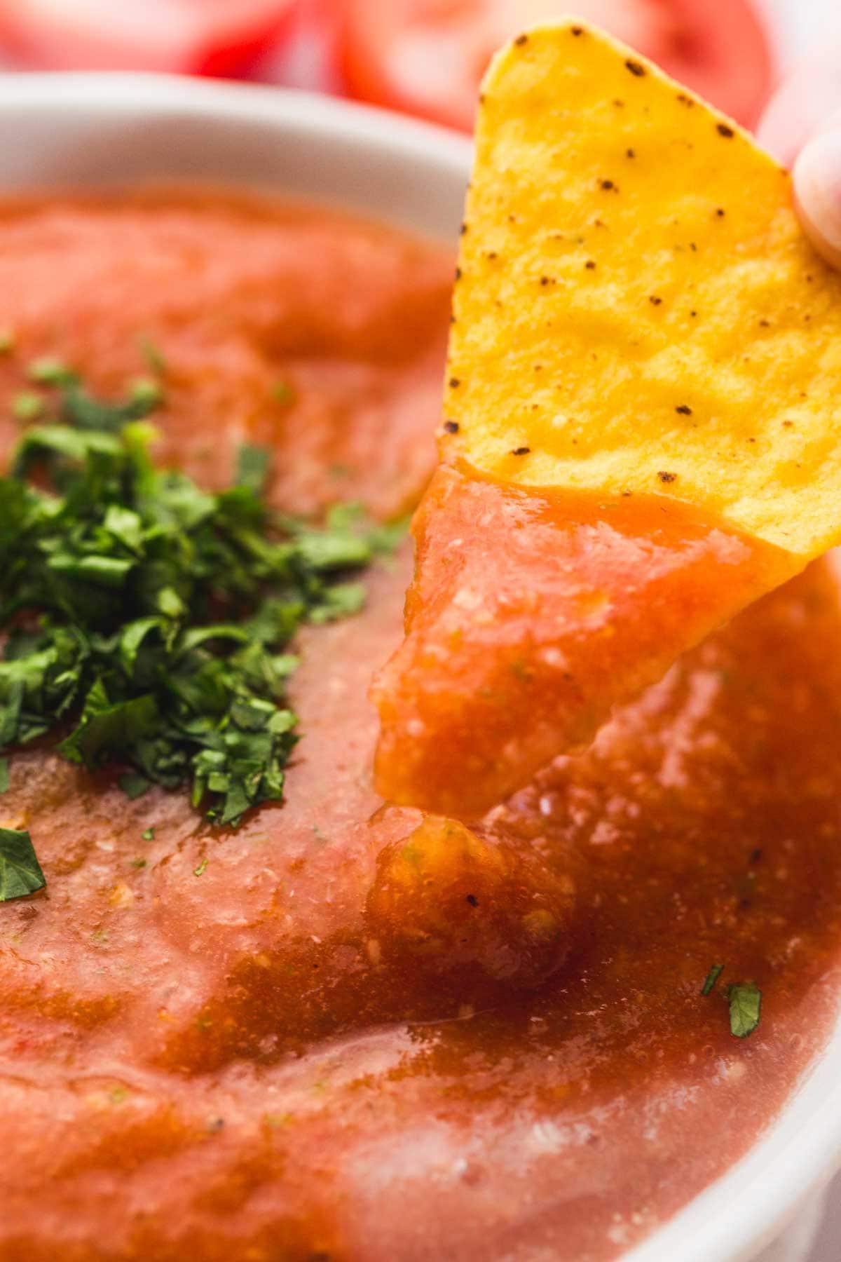 Salsa ranchera close up with a tortilla chip