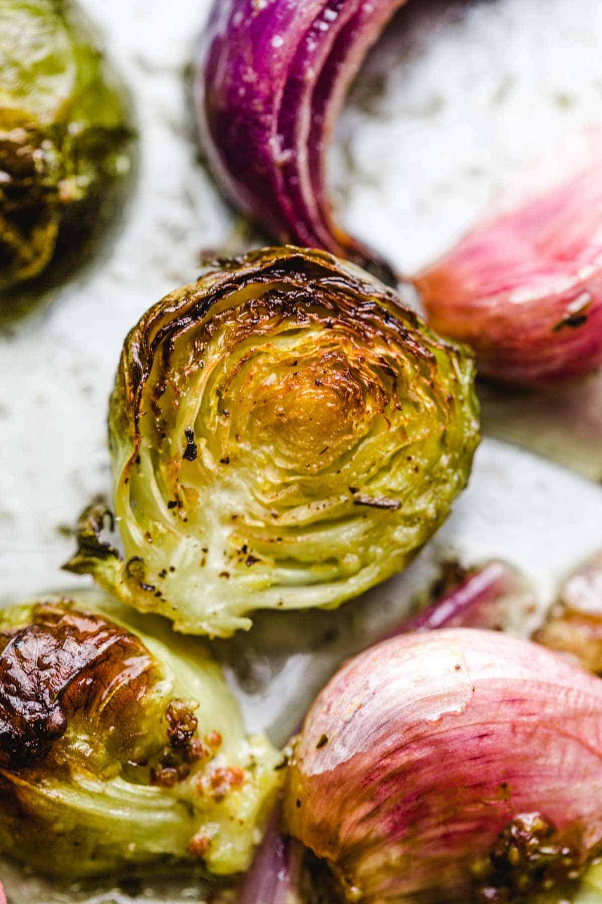 A close up shot of a roasted brussel sprout