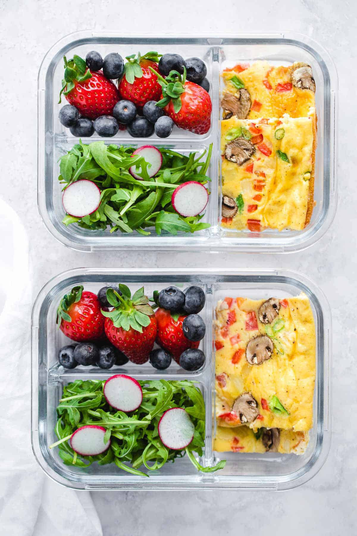 sheet pan eggs for meal prep with a side salad and fresh berries