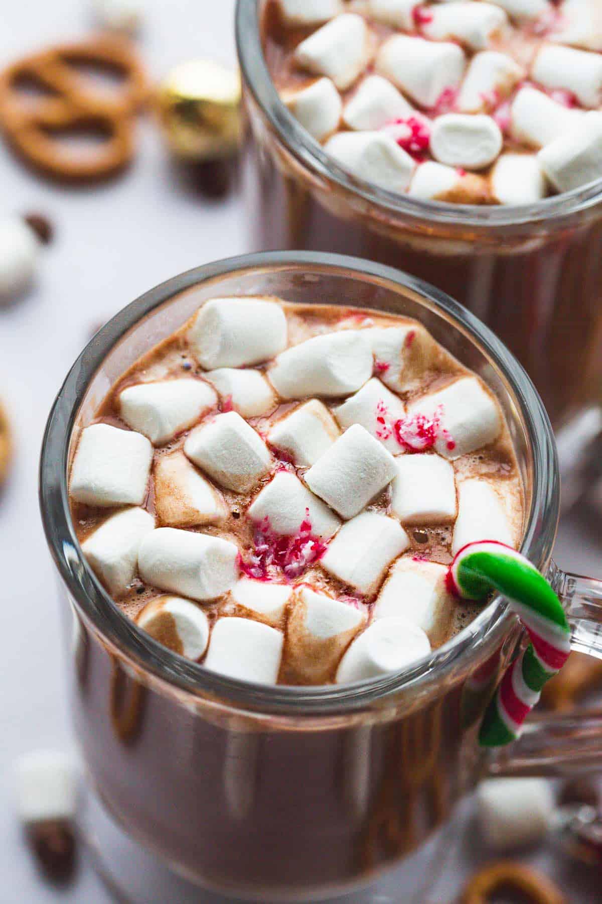 A close up shot of a mug with hot chocolate and marshmallows
