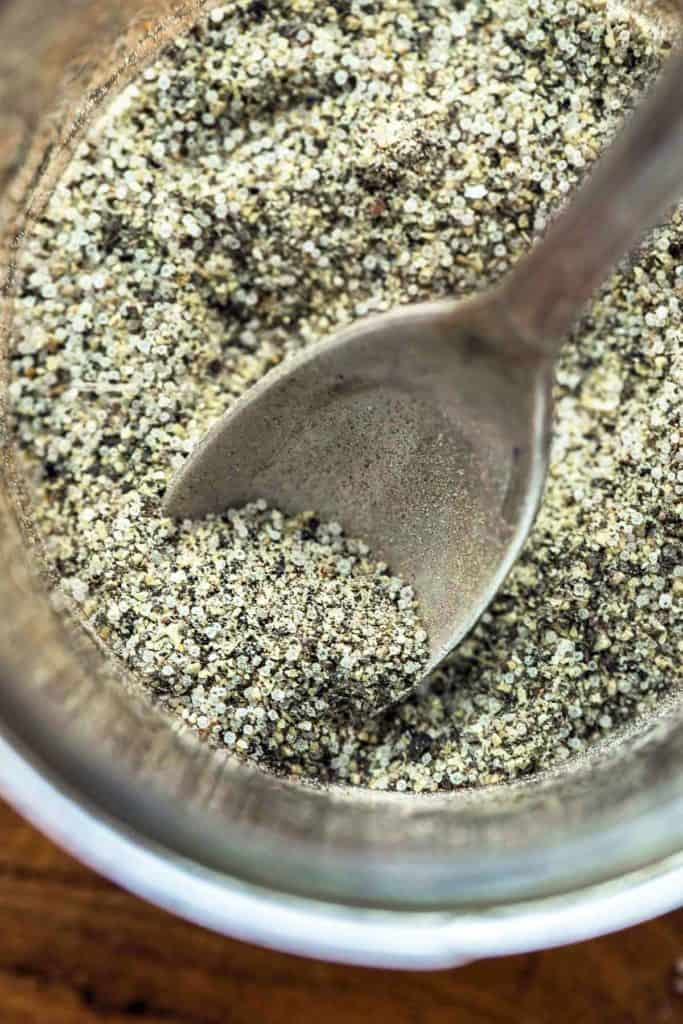 A close up shot of Stone House Seasoning in a jar with a spoon