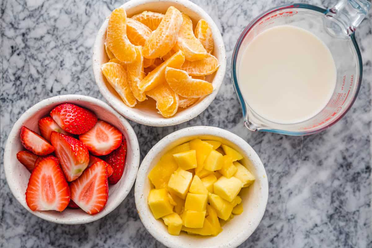 Strawberry Mango Smoothie prepped ingredients in bowls